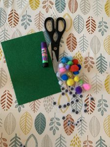 Materials - Pom poms, googly eyes, siscors, glue and felt