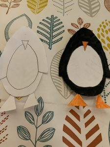 Two penguins cut out
