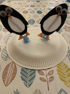 penguins stuck to the back of the plate